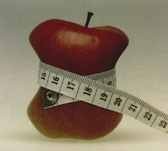 комбинация яблока и сантиметра